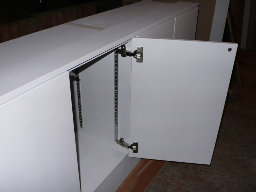 Push-to-open cabinet door