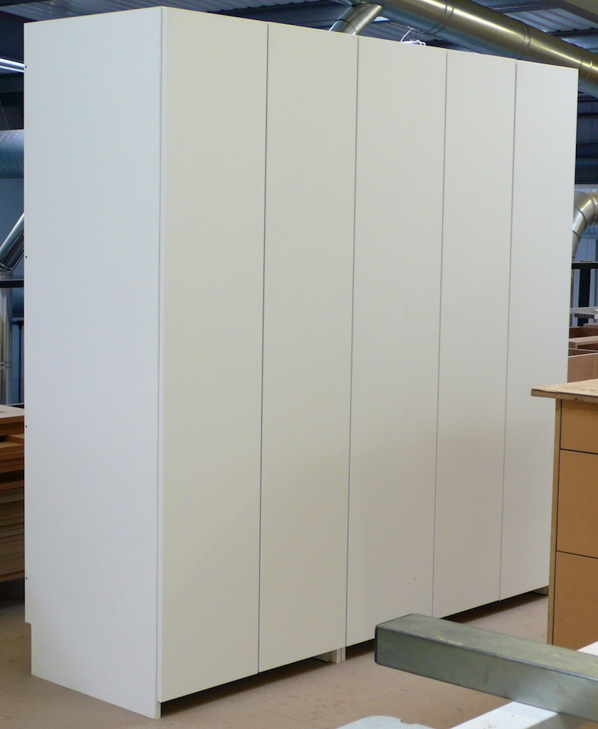 Wardrobe in white MFC comprising two sets of hanging space and a